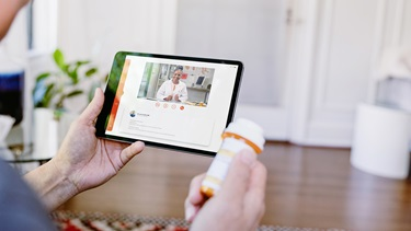 A patient having a virtual visit with a physician on a tablet